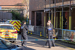 © Licensed to London News Pictures. 22/04/2021. Walton-on-Thames, UK. Police maintain a cordon at an alleyway entrance. Police responded to an incident at 14:15 BST on church Street in Walton-on-Thames, police and forensic investigators could be seen at he scene. Photo credit: Peter Manning/LNP