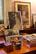 The Portland, Oregon home of Wendy Burden, author of  the memoir, Dead End Gene Pool.  The office off of the living room is filled with collectables and photographs.  Family portraits, including two photographs of Ms. Burden.