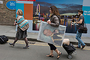 36 hours after the London Bridge and Borough Market terrorist attack, the capital returns to normality and Londoners return to their first day to work such as artist Jane Masojada with her portrait of Prince Phillip, on Monday 5th June 2017, in the south London borough of Southwark, England. Seven people were killed and many others left with life-changing injuries - but the British spirit of defiance and to carry on with every day life, endures.