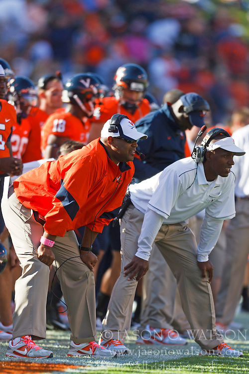 Oct 15, 2011; Charlottesville VA, USA;  Virginia Cavaliers head coach Mike London (left) and special teams coordinator Anthony Poindexter (right) on the sidelines during the second quarter against the Georgia Tech Yellow Jackets at Scott Stadium.  Virginia defeated Georgia Tech 24-21.  Mandatory Credit: Jason O. Watson-US PRESSWIRE