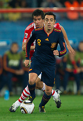 Xavi of Spain during the  2010 FIFA World Cup South Africa Quarter Finals football match between Paraguay and Spain on July 03, 2010 at Ellis Park Stadium in Johannesburg. (Photo by Vid Ponikvar / Sportida)