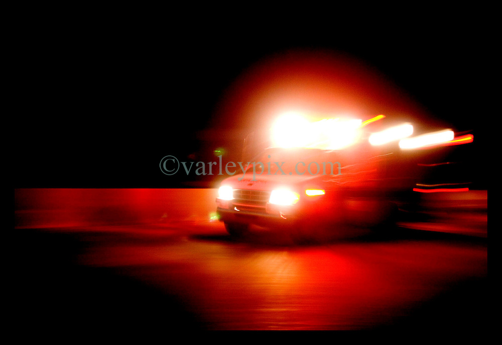29th August, 2005. Hurricane Katrina hits New Orleans, Louisiana. An ambulance races along Interstate 10 ferrying victims from the Lower 9th ward back into the city.