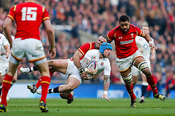 England Winger Jack Nowell is tackled by Wales Inside Centre Jamie Roberts - Mandatory byline: Rogan Thomson/JMP - 12/03/2016 - RUGBY UNION - Twickenham Stadium - London, England - England v Wales - RBS 6 Nations 2016.