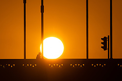 © Licensed to London News Pictures. 16/12/2018. London, UK.  A person walks across Tower Bridge as the sun begins to rise this morning following a cold night in the capital.  Photo credit: Vickie Flores/LNP