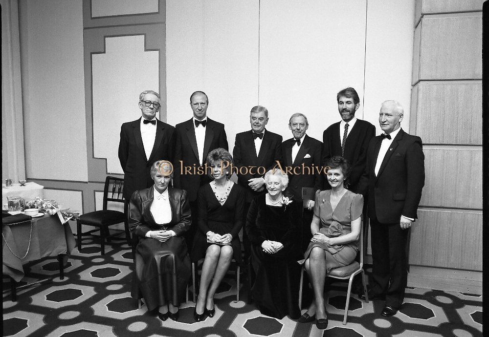 People Of The Year Awards.  (R91)..1988..22.11.1988..11.22.1988..22nd November 1988..This is the fourteenth year of the People of the Year Awards, sponsored by the New Ireland Assurance Company plc. The awards will be presented by Mr Ray Burke TD, Minister of Energy and Communications. Eight people have been nominated this year..Mr Ollie Jennings, for his contribution to community and cultural life of Galway City..Mr Jack Charlton, for restoration of pride to the Irish Soccer team..Ms Carmencita Hederman, For her efforts to instill a community spirit in Dublin..Maureen O'Mahony, for her dedication in assisting the sick and elderly in the Bantry area..Mr Tommy Boyle, for his contribution in having the Garda band ranked as one of the top bands in the world..Ms Alice Leahy, for a lifetime commitment in providing medical care to the Dublin Homeless..Ms Norma Smurfitt, for her voluntary contribution to the work of the Arthritis Foundation Of ireland..Mr Gordon Wilson, for his commitment to peace and reconcilliation in Northern Ireland...The award winners pose for pictures with Mr Eoin Ryan ,Chairman,New Ireland and Mr Joe Treacy, Rehab Irl, (both centre at back).