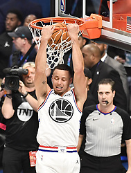 February 17, 2019 - Charlotte, NC, USA - Team Giannis' Stephen Curry, of the Golden State Warriors, goes up for a reverse two-handed dunk during the 2019 NBA All-Star 2019 game at Spectrum Center in Charlotte, N.C. on Sunday, February 17, 2019. (Credit Image: © David T. Foster Iii/Charlotte Observer/TNS via ZUMA Wire)