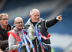 Inverness Caledonian Thistle's manager John Hughes. Inverness Caledonian Thistle lifts the cup. Falkirk 1 v 2 Inverness CT, Scottish Cup final at Hampden.