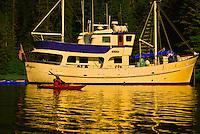 Passenger of the Ursa Major charter ship sea kayaking in Red Bluff Bay, Inside Passage, Southeast Alaska