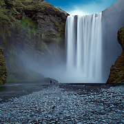 Waterfalls abound in Iceland, and the powerful Skógafoss is one of her most famous.  Situated in the south of Iceland at the cliffs of the former coastline, it is easy to spot from the Ring Road near Skógar.