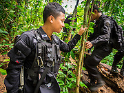 16 JUNE 2015 - CHUAP, NARATHIWAT, THAILAND:  A Thai Army Ranger maintains perimeter security in a Muslim insurgent camp after Rangers recovered three M16 assault rifles in the camp. Thai Rangers, a paramilitary force of the Thai Army, discovered a Muslim insurgent camp in the village of Chuap, in Narathiwat province last week. Most of the insurgents in the camp escaped into the surrounding jungle, but soldiers captured two insurgents and recovered three M16 assault rifles. Two of the three rifles were stolen from the Thai Army in 2004. Investigators are still tracing the source of the third rifle. The Rangers took Thai media into the camp Tuesday. About 6,000 people have been killed in sectarian violence in Thailand's three southern provinces of Narathiwat, Pattani and Yala since a Muslim insurgency started in 2004. Attacks usually spike during religious holidays. Insurgents are fighting for more autonomy from the central government in Bangkok.      PHOTO BY JACK KURTZ