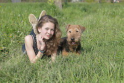 Teenage girl in park with her dog, Freiburg im Breisgau, Baden-Wuerttemberg, Germany