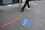With most shops now open but with retail sales suffering due to the Coronavirus pandemic, daily life continues with social distancing markings on the streets on 2nd July 2020 in London, United Kingdom. Coronavirus or Covid-19 is a respiratory illness that has not previously been seen in humans. While much or Europe has been placed into lockdown, the UK government has put in place more stringent rules as part of their long term strategy, and in particular social distancing.