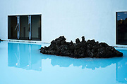 A piece of lava in the pool at the entrance to the Blue Lagoon resort. Iceland.
