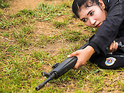 17 JUNE 2015 - RANGAE, NARATHIWAT, THAILAND: Thai women Rangers drill with HK33 Assault Rifles. There are 5 platoons of women Rangers serving in Thailand's restive Deep South. They generally perform security missions at large public events and do public outreach missions, like home wellness checks and delivering food and medicine into rural communities. The medics frequently work in civilian clothes because the Rangers found people are more relaxed around them when they're in civilian clothes. About 6,000 people have been killed in sectarian violence in Thailand's three southern provinces of Narathiwat, Pattani and Yala since a Muslim insurgency started in 2004. Attacks usually spike during religious holidays. Insurgents are fighting for more autonomy from the central government in Bangkok.      PHOTO BY JACK KURTZ