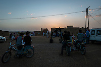Locals gather to watch the wedding celebrations of a Sudanese Berber community in Merzouga, Morocco.