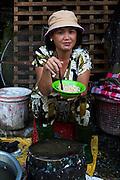 Portrait of a lady eating noodles, Ho Chi Minh City