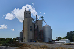 31 July 2015:  Holder Illinois. A grain elevator in a midwest town is needed for trade and to keep the agricultural breadbasket of the world functioning.  They also double as landmarks and help to give small communities identities.  They are often thought of as midwestern skyscrapers as they can define a skyline and are often taller than even a towns water tower.<br /> <br /> <br /> This image was produced in part utilizing High Dynamic Range (HDR) processes.  It should not be used editorially without being listed as an illustration or with a disclaimer.  It may or may not be an accurate representation of the scene as originally photographed and the finished image is the creation of the photographer.