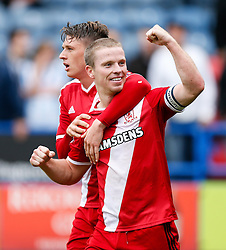 Grant Leadbitter of Middlesbrough celebrates with Adam Reach after scoring a goal from the Penalty Spot to give his side a 1-2 lead late in the match - Photo mandatory by-line: Rogan Thomson/JMP - 07966 386802 - 13/09/2014 - SPORT - FOOTBALL - Huddersfield, England - The John Smith's Stadium - Huddersfield town v Middlesbrough - Sky Bet Championship.