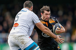 Wasps Scrum-Half Charlie Davies is tackled by Castres Olympique Lock Benjamin Desroche - Photo mandatory by-line: Rogan Thomson/JMP - 07966 386802 - 14/12/2014 - SPORT - RUGBY UNION - High Wycombe, England - Adams Park Stadium - Wasps v Castres Olympique - European Rugby Champions Cup Pool 2.