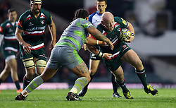 Leicester Tigers Dan Cole is tackled by Newcastle Falcons Sam Lockwood during the Aviva Premiership match at Welford Road, Leicester.