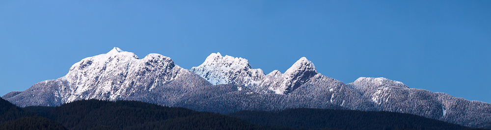The Golden Ears Mountains - Mount Blanshard, Edge Peak, Blanshard Peak, and Alouette Mountain - make up the Mount Blanshard massif in British Columbia.  Photographed from Pitt Meadows, British Columbia, Canada