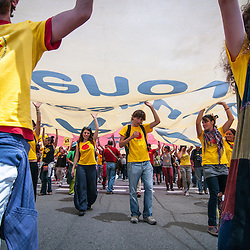 A group of young Greenpeace protestors carry a huge banner in an anti-nuclear protest in Barcelona.