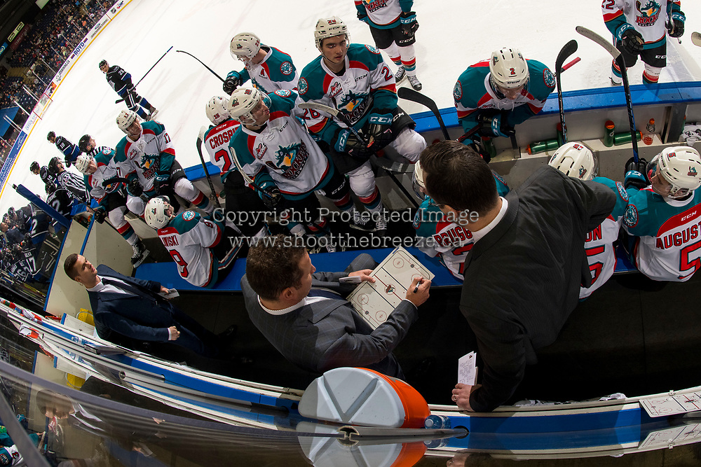 KELOWNA, CANADA - JANUARY 25: Kelowna Rockets' head coach Adam Foote goes over a play on the bench during a time out against the Victoria Royals  on January 25, 2019 at Prospera Place in Kelowna, British Columbia, Canada.  (Photo by Marissa Baecker/Shoot the Breeze)
