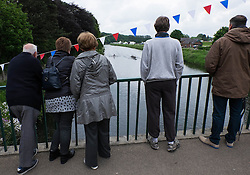 © Licensed to London News Pictures.13/06/15<br /> Durham, England<br /> <br /> Spectators watch the rowing from a bridge during the 182nd Durham Regatta rowing event held on the River Wear. The origins of the regatta date back  to commemorations marking victory at the Battle of Waterloo in 1815. This is the second oldest event of this type in the country and attracts over 2000 competitors from across the country.<br /> <br /> Photo credit : Ian Forsyth/LNP