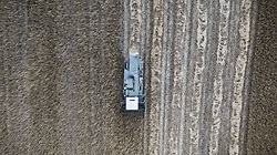 June 10, 2017 - San Pietro Vernotico, Italy - A drone view of farmer works during harvest wheat in San Pietro Vernotico, South of Italy, on June 10, 2017. (Credit Image: © Manuel Romano/NurPhoto via ZUMA Press)
