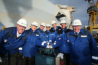 Oasis of the Seas. Float Out, Turku, Finland..Royal Caribbean's Oasis of the Seas the worlds largest cruise ship, enters final construction phase  at STX ship yard in Finland..Wheel turning to flood the dry dock..L-R Captain William Wright ( SVP Marine operations) Arne Wilhelmsen (Founder RCCL) Richard Fain (Chairman and CEO Royal Caribbean) Harri Kulovaara (Senior VP Marine Royal Caribbean) Martin Landtman (President, STX Finland Cruise) Toivo Ilvonen (Project Director Oasis Class) Gjert Wilhelmsen (founder RCCL)