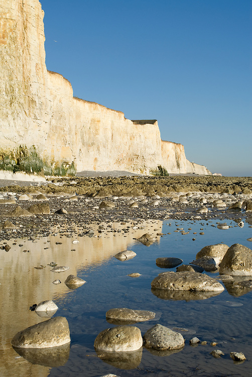 Low tide and white cliffs at Telscombe on the East Sussex coast, near Brighton, England.