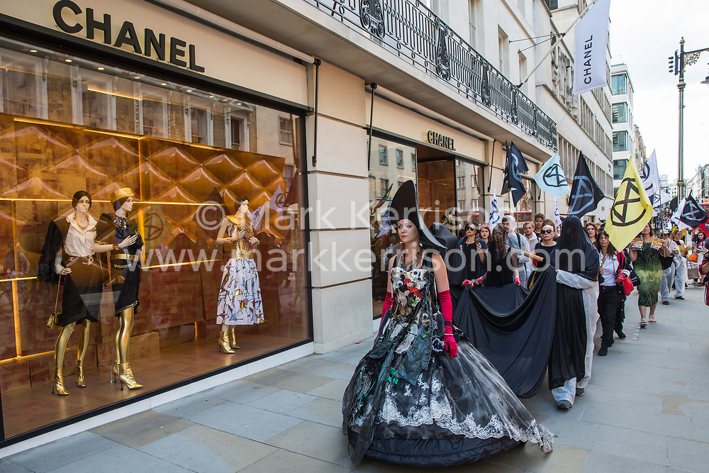 London, UK. 2 July, 2019. Climate change activists from Extinction Rebellion Art and Culture walk along New Bond Street during a silent procession visiting the offices of five major oil companies - ENI, CNPC, Saudi Aramco, Repsol and BP - to declare them a crime scene.