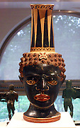 Terracotta vase in the form of a black African youth's head. Etruscan 4th century B.C.