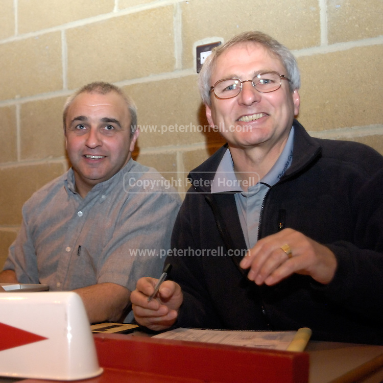DAGENHAM - MAY 17: Essex Metropolitan Basketball League Chairman, Brian Pittman, and K. Bates (on left) were the table officials for the Essex Metropolitan Basketball League Play Off final at Sydney Russell School. Erks beat Cardinals 81 - 68. This was Brian Pittman's last EMBL Final as Chairman since he has stated that he will be stepping down at the next AGM.