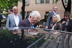 London, May 19th 2014. Rolf Harris leaves Southwark Crown Court after another day of his trial on 12 counts of indecent assault against girls aged between 7 and 19.