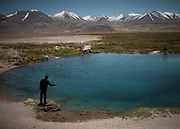 A famous holy spring near Alichur village.<br /> <br /> Driving on the Pamir Highway (M41) from Khorog through the Pamir mountains.<br /> <br /> Tajikistan, a mountainous landlocked country in Central Asia. Afghanistan borders it to the south, Uzbekistan to the west, Kyrgyzstan to the north, and People's Republic of China to the east. Tajikistan also lies adjacent to Pakistan separated by the narrow Wakhan Corridor.<br /> Tajikistan became a republic of the Soviet Union in the 20th century, known as the Tajik Soviet Socialist Republic.<br /> It was the first of the Central Asian republic to gain independence in December 1991.