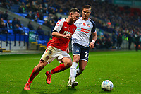 Fleetwood Town's Lewis Coyle vies for possession with  Bolton Wanderers' Dennis Politic<br /> <br /> Photographer Richard Martin-Roberts/CameraSport<br /> <br /> The EFL Sky Bet League One - Bolton Wanderers v Fleetwood Town - Saturday 2nd November 2019 - University of Bolton Stadium - Bolton<br /> <br /> World Copyright © 2019 CameraSport. All rights reserved. 43 Linden Ave. Countesthorpe. Leicester. England. LE8 5PG - Tel: +44 (0) 116 277 4147 - admin@camerasport.com - www.camerasport.com