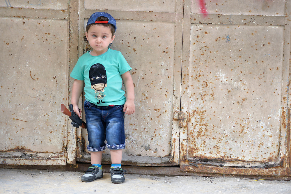 A boy with a toy gun in the Al-Shalti refugee camp in Gaza. Residents of the Palestinian territory are still reeling from the death and destruction of the 2014 war with Israel, and the continuing siege of the seaside territory by the Israeli military.