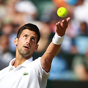 LONDON, ENGLAND - JULY 12:  Novak Djokovic of Serbia in action against Tomas Berdych of the Czech Republic in the Mens' Singles Quarter Final match on Court One during the Wimbledon Lawn Tennis Championships at the All England Lawn Tennis and Croquet Club at Wimbledon on July 12, 2017 in London, England. (Photo by Tim Clayton/Corbis via Getty Images)
