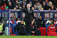 Alan Pardew, the Crystal Palace manager looks on from the touchline. Barclays Premier League match, Crystal Palace v Chelsea at Selhurst Park in London on Sunday 3rd Jan 2016. pic by John Patrick Fletcher, Andrew Orchard sports photography.