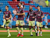 Football - 2021 / 2022 Premier League - Burnley vs. Arsenal<br /> <br /> Cedric Soares, Pablo Mari, Alexandre Lacazette and Gabriel Martinelli of Arsenal warm up before the game today, at Turf Moor.<br /> <br /> <br /> COLORSPORT/ALAN MARTIN