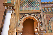 Bab Mansour gate, named after the architect, El-Mansour, completed in 1732. The design of the gate plays with Almohad patterns. It has zellij mosaics and the marble columns were taken from the Roman ruins of Volubilis. Meknes, Morocco .<br /> <br /> Visit our MOROCCO HISTORIC PLAXES PHOTO COLLECTIONS for more   photos  to download or buy as prints https://funkystock.photoshelter.com/gallery-collection/Morocco-Pictures-Photos-and-Images/C0000ds6t1_cvhPo<br /> .<br /> <br /> Visit our ISLAMIC HISTORICAL PLACES PHOTO COLLECTIONS for more photos to download or buy as wall art prints https://funkystock.photoshelter.com/gallery-collection/Islam-Islamic-Historic-Places-Architecture-Pictures-Images-of/C0000n7SGOHt9XWI