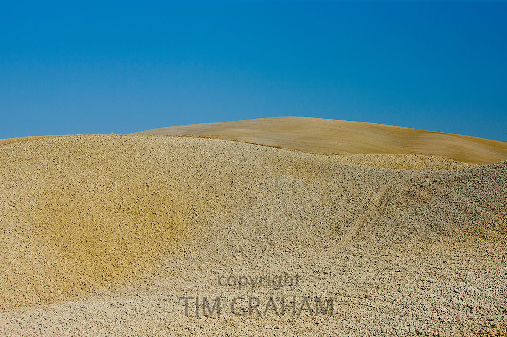 Tuscan parched landscape sun-baked soil  in Val D'Orcia, Tuscany, Italy
