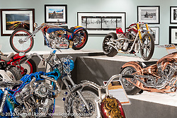 Fred Cuba's split rocker, dual plugged, de-finned Ironhead Sportster Red Wheel Bike (L) beside Roland Sands Discovery Channel BBO Glory Stomper in the Heavy Mettle - Motorcycles and Art with Moxie exhibition at the Sturgis Buffalo Chip. This is the 2020 iteration of the annual Motorcycles as Art series curated and produced by Michael Lichter. Sturgis, SD, USA. Friday, August 7, 2020. Photography ©2020 Michael Lichter.