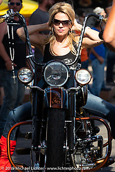 Melissa Kitowski on a new bike from Dino's Custom Choppers at the Rats Hole annual custom bike show in the Crossroads area of the Buffalo Chip during the Sturgis Black Hills Motorcycle Rally. SD, USA. Thursday, August 8, 2019. Photography ©2019 Michael Lichter.