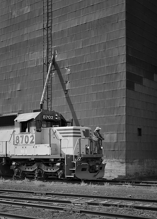 Passing the elevators of Davenport, crewmen from the Eastern Washington Gateway Railroad  prepare to switch a car.