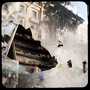 A smashed shop front of a looted music store in Athens. <br /> <br /> Following the murder of a 15 year old boy, Alexandros Grigoropoulos, by a policeman on 6 December 2008 widespread riots, protests and unrest followed lasting for several weeks and spreading beyond the capital and even overseas<br /> <br /> When I walked in the streets of my town the day after the riots I instantly forgot the image I had about Athens, that of a bustling, peaceful, energetic metropolis and in my mind came the old photographs from WWII, the civil war and the students uprising against the dictatorship. <br /> <br /> Thus I decided not to turn my digital camera straight to the destroyed buildings but to photograph through an old camera that worked as a filter, a barrier between me and the city.