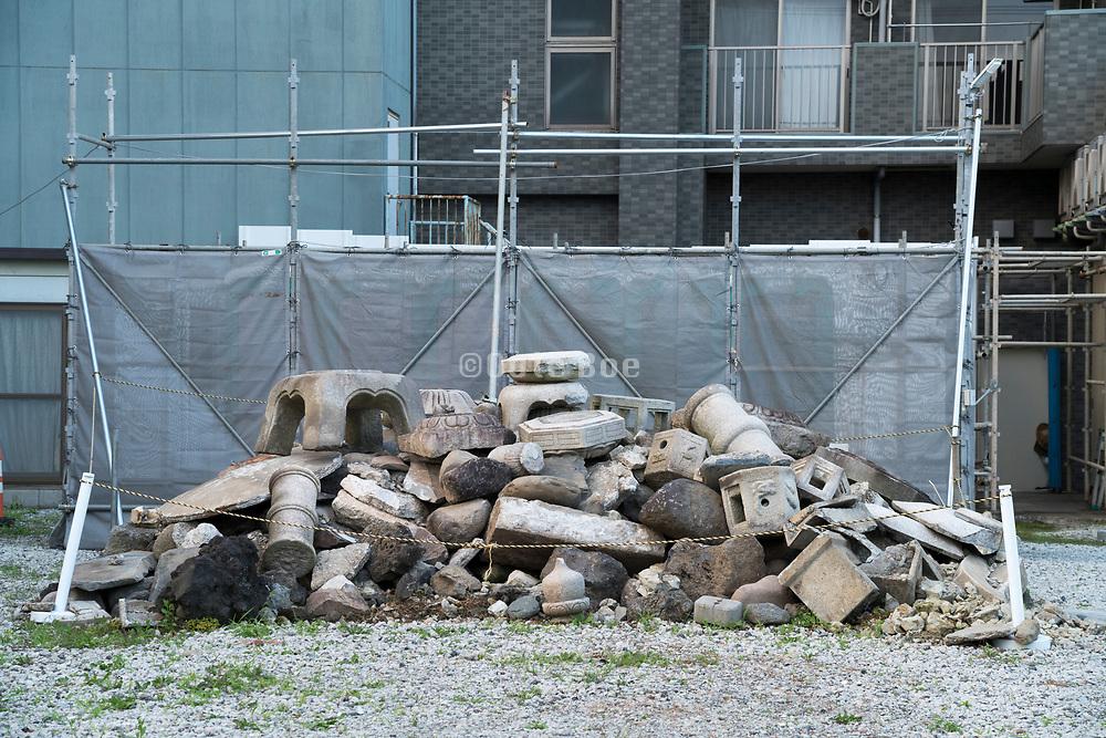 broken down stone heap of a Japanese shrine