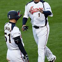 22 March 2009: #1 Kosuke Fukudome of Japan celebrates with #51 Ichiro Suzuki after scoring during the 2009 World Baseball Classic semifinal game at Dodger Stadium in Los Angeles, California, USA. Japan wins 9-4 over Team USA.