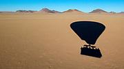 Shadow of a hot air balloon preparing to land in the Namib-Naukluft National Park, Namibia.